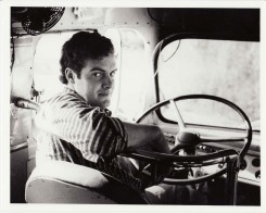 Peter Rowan at the helm of Bill Monroe's tour bus. Photo courtesy of Herb Peck.